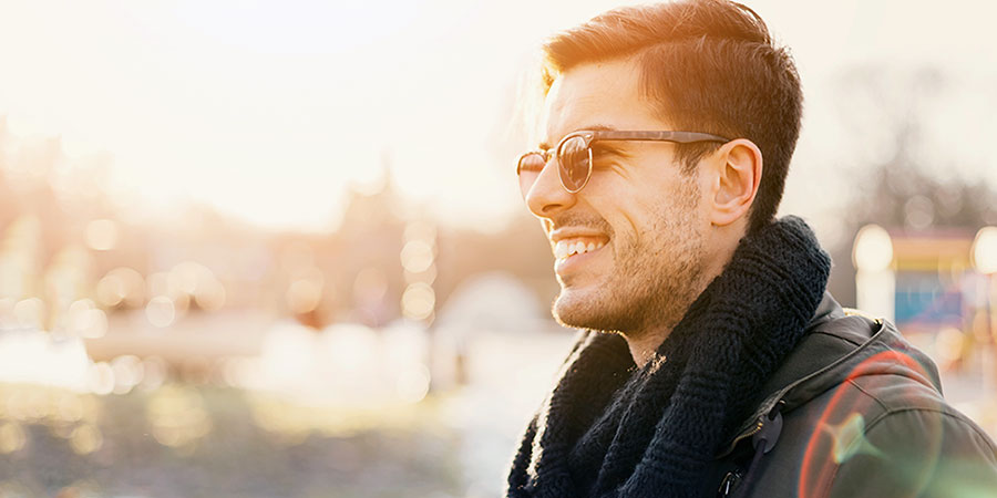 Smiling man outside wearing sunglasses