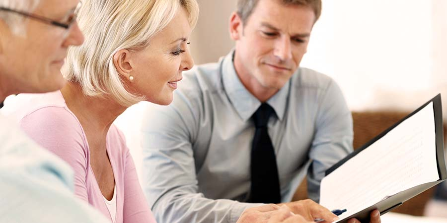 Couple reviewing their financials with guidance from an expert