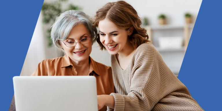 Mother and daughter looking at a website