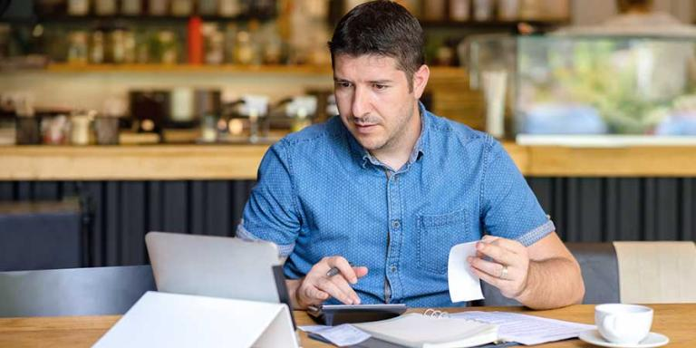 Small business owner looking over financial documents