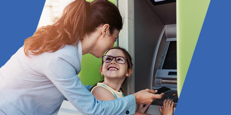 Woman and daughter at an ATM