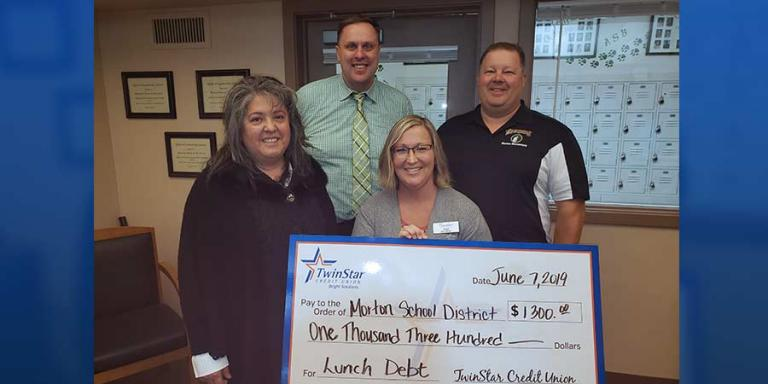 Onalaska Branch Manager Erin McKinnel pictured here with representatives from the Morton School District.